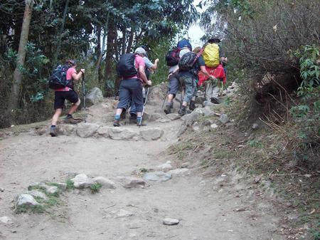 The team trekked up steep paths