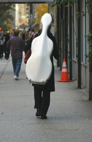 Person carrying cello case