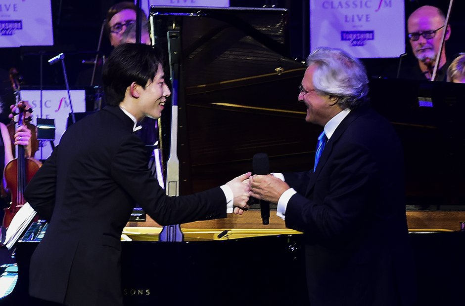 Ji Liu and John Suchet