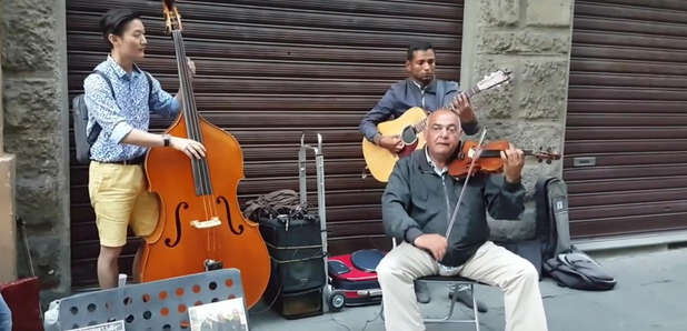 double bassist joins busking band