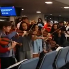 youth orchestra play elgar in airport